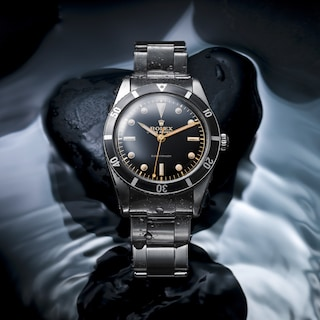 1953 - The first divers' wristwatch waterproof to a depth of 100 metres (330 feet), the Submariner marked a major step forward in the history of Rolex and of deep-sea diving.